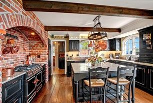Rustic Kitchen with Ceramic Tile, Exposed beam, Simple granite counters, Mauviel - 1830 Copper 6 1/2-Qt. Dutch Oven, U-shaped