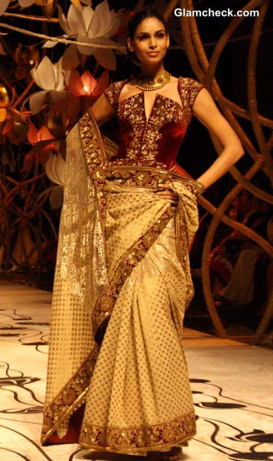 Corset Blouses with Golden Saree - Rohit Bal India Bridal Fashion Week 2013 C ollection #saree #indian wedding #fashion #style #bride #bridal party #brides maids #gorgeous #sexy #vibrant #elegant #blouse #choli #jewelry #bangles #lehenga #desi style #shaadi #designer #outfit #inspired #beautiful #must-have's #india #bollywood #south asain