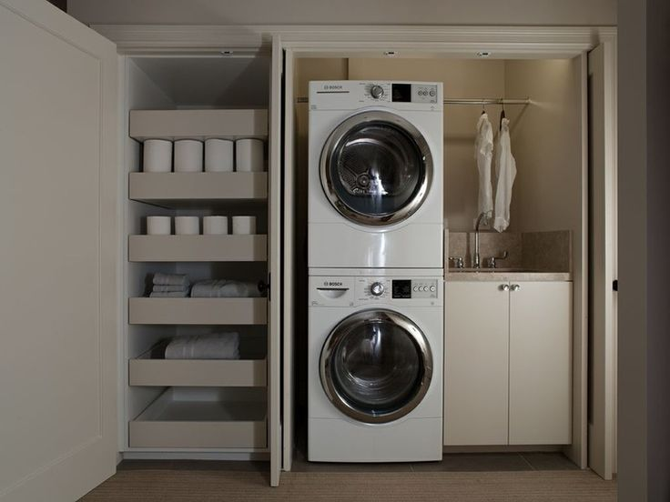 Love the pivot doors! Guests would walk in and wonder, Where's the washer and dryer?? Contemporary Laundry Room by K.G.Bell Construction