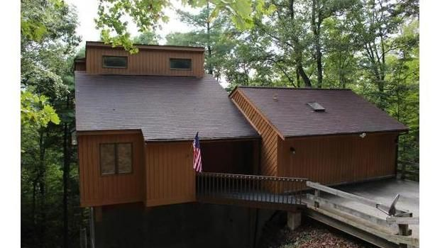 This home has the best of both worlds. Just minutes to downtown Asheville and the Blue Ridge Parkway. The home is nestled in trees and feels like a tree house. There is plenty of deck space to entertain and enjoy the views. Over-sized master on main level. Second bed and full bath on main. Loft that would be perfect for office or bonus space. Seller offering $2,500 upgrades/appliance allowance with acceptable offer.