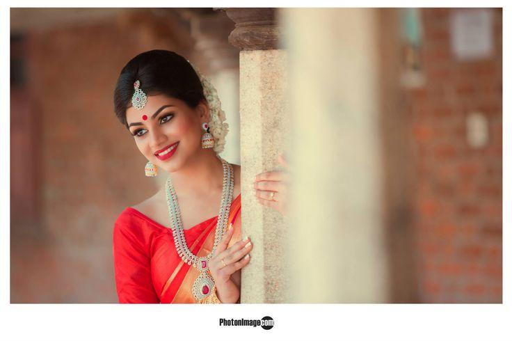 Traditional Southern Indian bride wearing bridal saree, jewellery tamil wedding , london tmail wedding , srilankan tamil wedding photonimage.com/