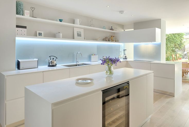 Kitchen in coloured satin matt lacquer with glacier white Corian worktop and back painted glass splashback by INTERIOR ID