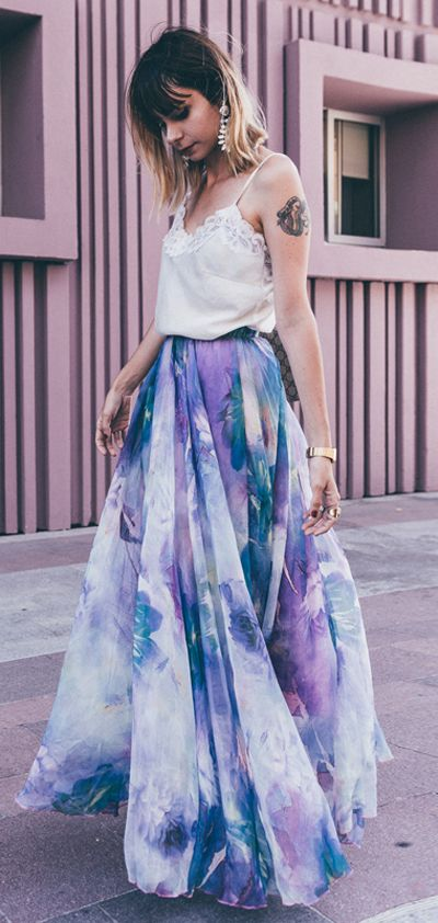 With its soft purple print and flowy hemline, this skirt is a stylish way to catch the breeze while you shoot the breeze this summer. Dancing Watercolor Floral Maxi Skirt in Violet featured by Natacha-birds Blog