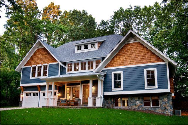 Cute blue Craftsman home exterior with cedar shingle siding.