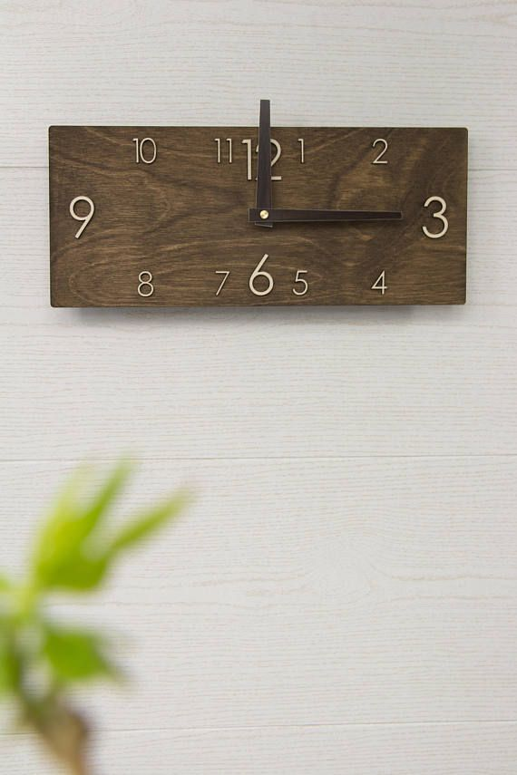 this very lovely modern wooden wall clock in rectangular shape performed in a dark brown