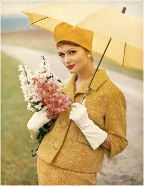 Isabella Albonico in lemon gold wool tweed suit by George Carmel, hat by Emme, Marvella earrings, photo by Gleb Derujinsky, Harper's Bazaar, February 1960