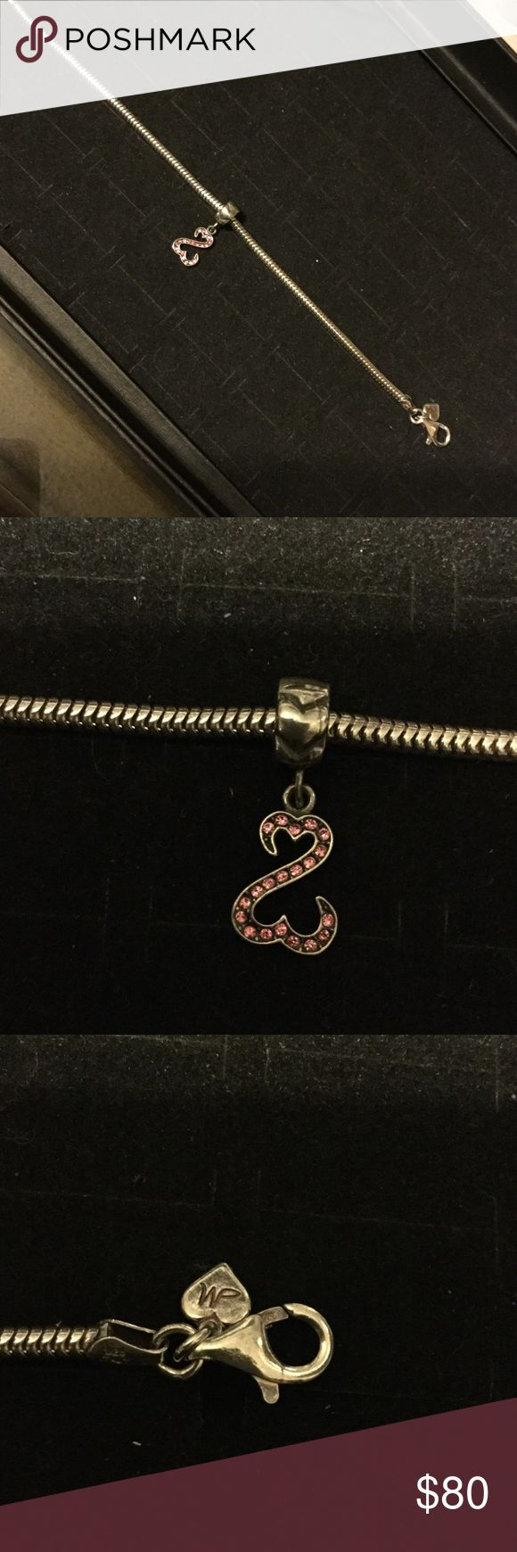 Preowned Kay Jewelers Bracelet with pink Charm Preowned 925 SS Kay Jewelers Bracelet (CHARMED MEMORIES). Lobster clasp. Comes with SS Pink Swarovski Open ♥️ hearts charm by Jane Seymour. No missing Crystal. I try 2 provide specific detail including imperfections so there won't be any misinterpretation,miscommunication & dissatisfaction w purchase. Please look at all the pictures  ask any questions before purchase. Thank you 😊 🙏😍❤️😜 Kay Jewelers Jewelry Bracelets