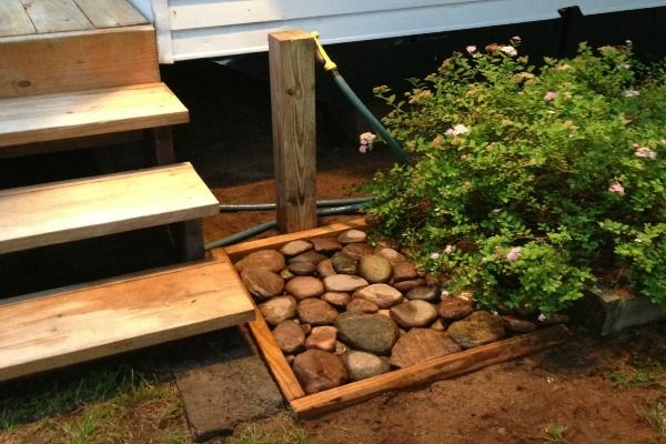 How to Create an Outdoor Foot Washing Station. Summer activities often leave feet dirty. Hose them off in this simple DIY to keep your house's floors clean!