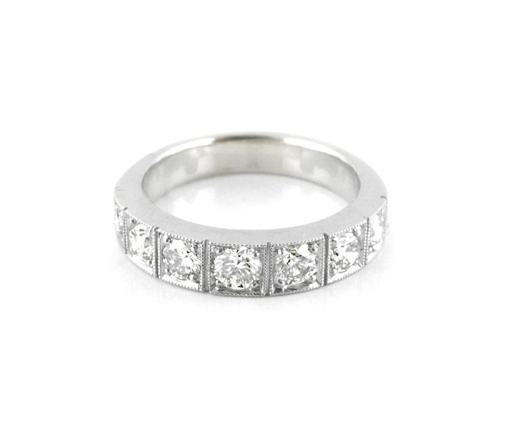 An 18ct White Gold and Diamond Box Pave Eternity Ring