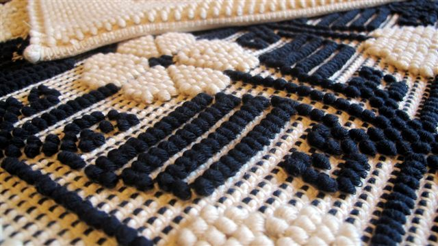 The weaving technique called 'Pibiones' (grapes) which uses a distinctive relief effect, Ulassai, Ogliastra