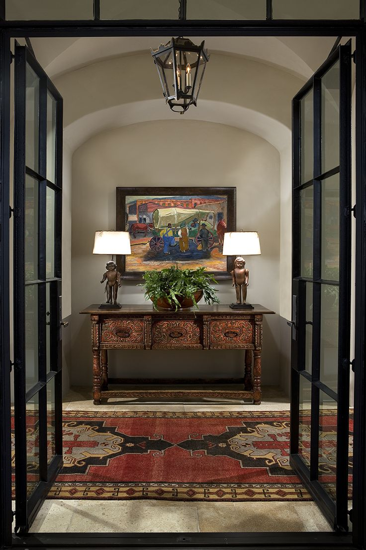 Beautiful spanish colonial entry on this candelaria design for Colonial foyer ideas