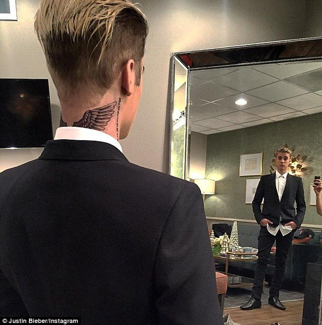 He Beliebs in angels: Justin Bieber unveiled his new wings tattoo on the back of his neck via an Instagram photo on Thursday