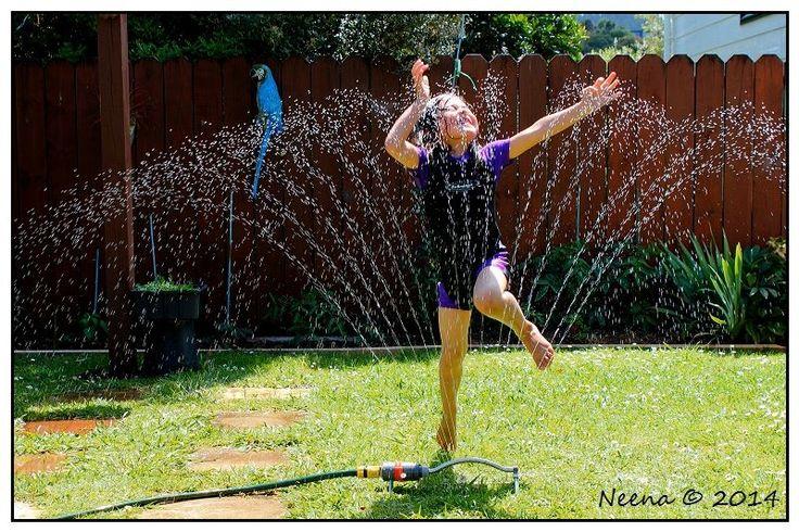 Summer fun in the garden sprinkler!