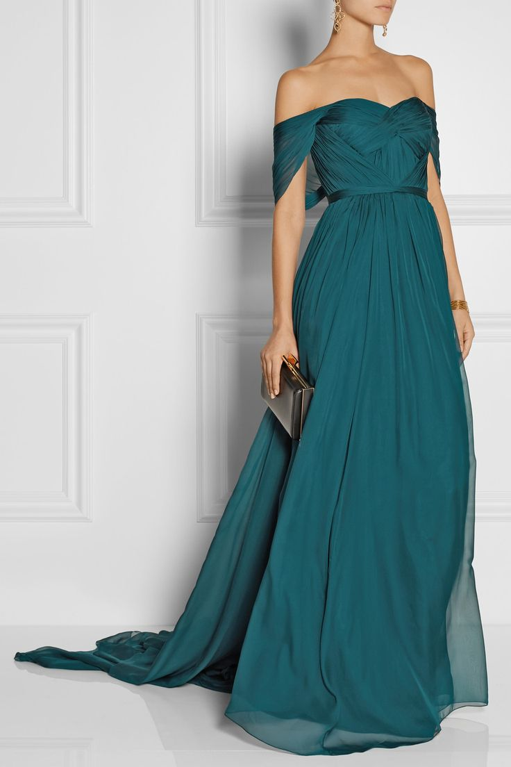 Marchesa|Off-the-shoulder silk-chiffon gown|NET-A-PORTER.COM EDITORS' NOTES & DETAILS Designed with a sculpted bodice and a sweeping train, Marchesa's silk-chiffon gown will make an unforgettable option for formal events. The deep teal hue flatters all skin tones, and the off-the-shoulder neckline adds to the romantic feel. Style yours with statement earrings and an updo.
