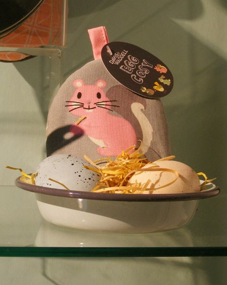 Davis and Waddell, squirrel egg cosy with a pair of eggs in an enamel dish, woodstraw 'nest'.  Easter Kitchenware window display for London and American Supply Stores, Melbourne Australia Display and image by Patricia Denis