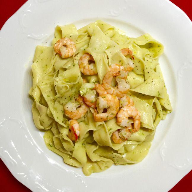 Homemade pasta with wild garlic pesto and prawns