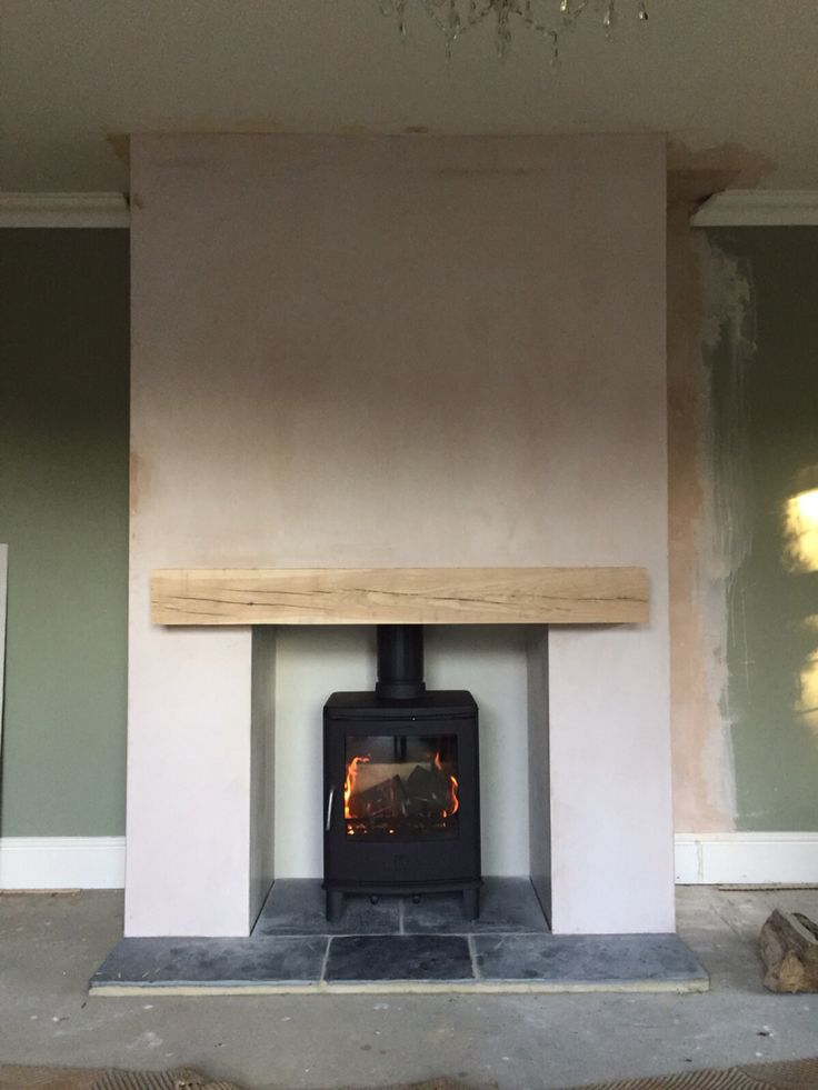 Scan anderson 4 5 oak beam new plastered chimney breast for Tiled chimney breast images