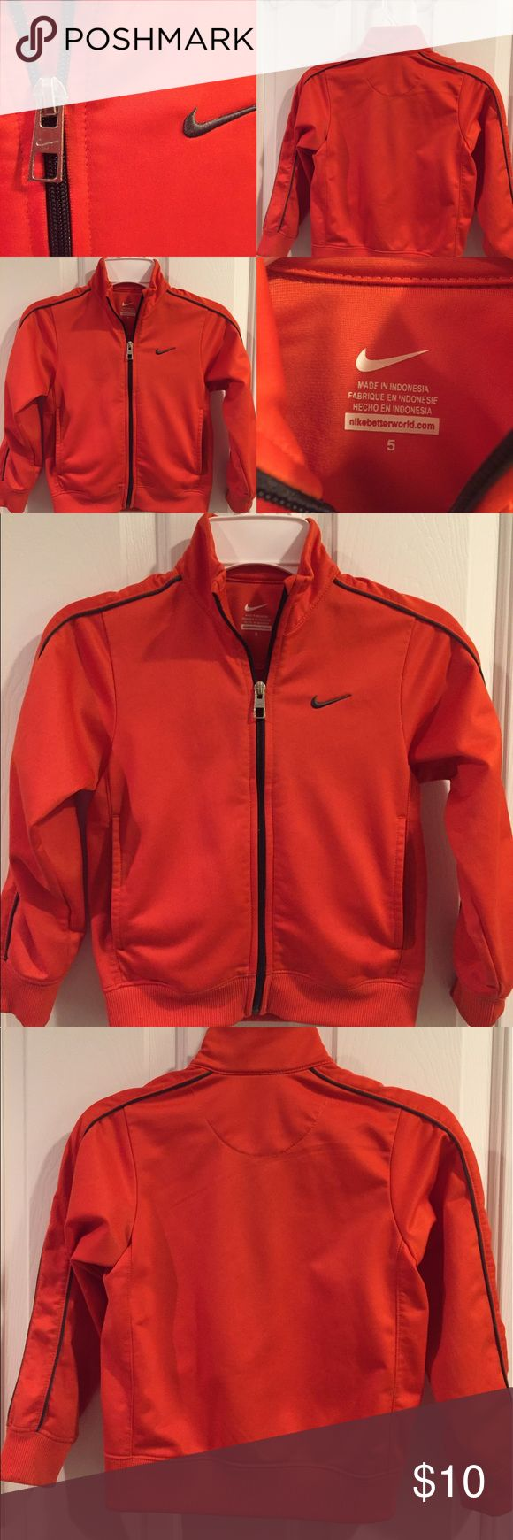 Orange Nike Track Jacket 5T EUC Orange Nike Track Jacket 5T. This jacket has been washed but never dried. It is now ready for a new home! Nike Jackets & Coats