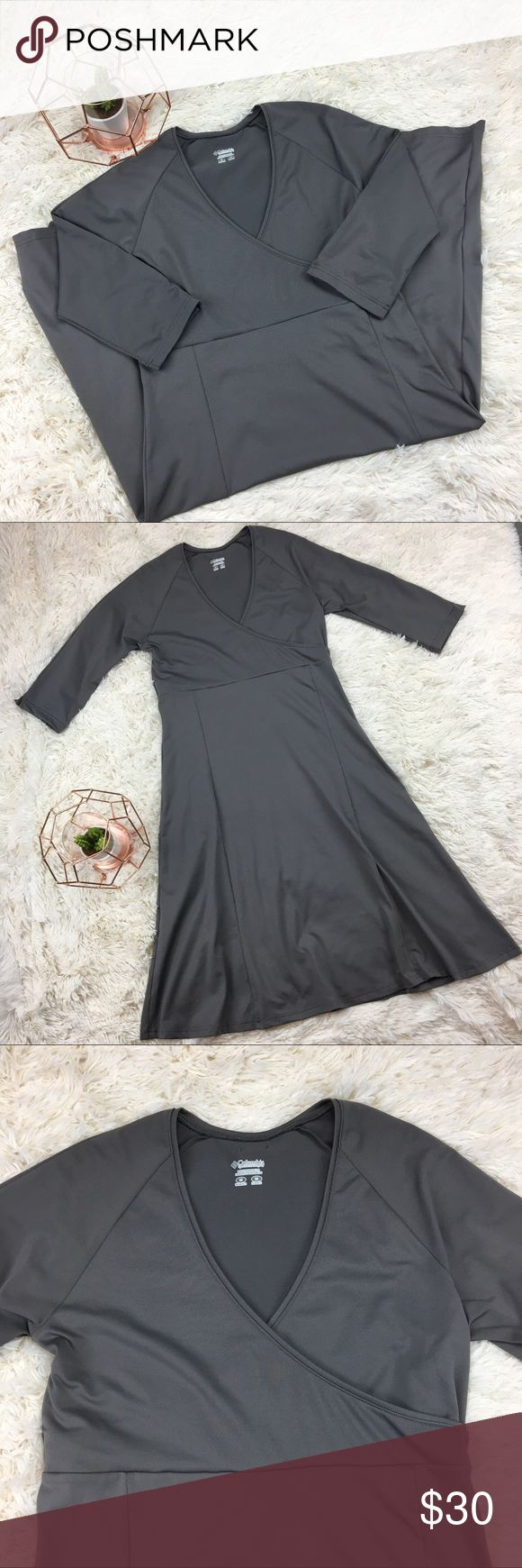 Columbia Grey 3/4 Sleeve Dress w/ Cross Bust Grey Columbia dress with Vneck cross bust and 3/4 sleeves. Great stretchy material. Perfect casual dress. Similar styling to Patagonia Bandha dresses. Preloved. Please refer to photos for measurements. Columbia Dresses Midi