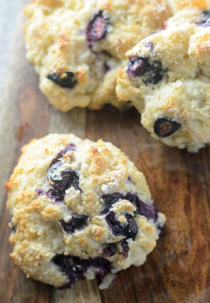Easy Blueberry Scones made with Greek yogurt, blueberries, lemon and brown sugar. This recipe includes how to make instructions and tips for light fluffy scones.