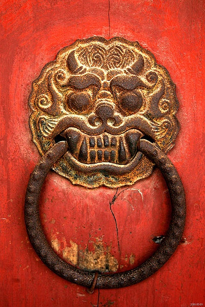 Knocker Gyeongju, North Gyeongsang province, South Korea (The knocker has been nailed to the door, I guess they don't want to be disturbed)