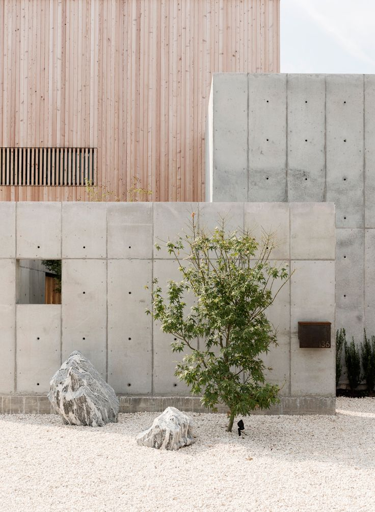 courtyards and skylights illuminate the private home by christopher robertson which is constructed from three components making up the building form.