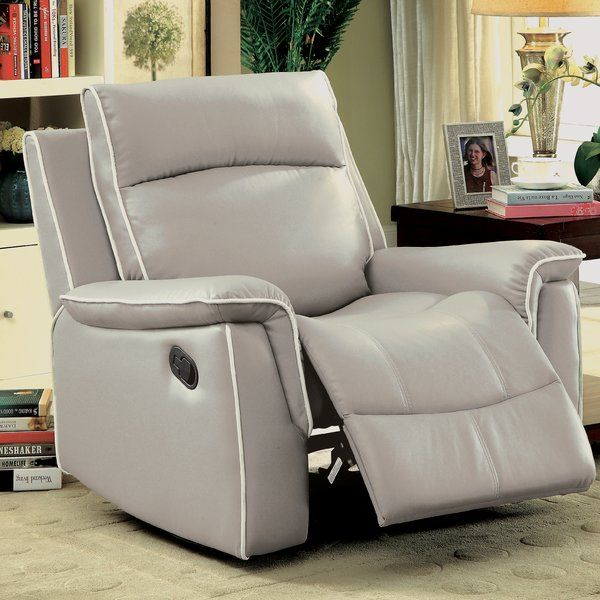 Flip up the footstool and lean back to relax in style atop this contemporary reclining chair! The manual recline feature provides a perfect opportunity to stretch out and enjoy some down time. Extra padding along the headrest and pillow-top armrests add even more comfort to ensure a more enjoyable experience while the contrasting welt trim adds sleek style to the design. Upholstered in a beautiful faux leather, this reclining piece adds chic visual appeal as well as unrivaled comfort to your…