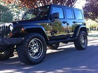 I am selling this Jeep for my father-in-law but I got to drive it for the past few months. It is a sweet looking car. It is black exterior with 35 tires and chrome rims. I would love to buy it myself because it has been such a fun car to drive but the wife wont let me.  It has a lot of sick upgrades. It comes with GPS, AUX input, multi CD player, touch screen, 4WD.  Also comes with a hardtop, which makes it a great vehicle for winter, and the hardtop is easily removed for the summer time…