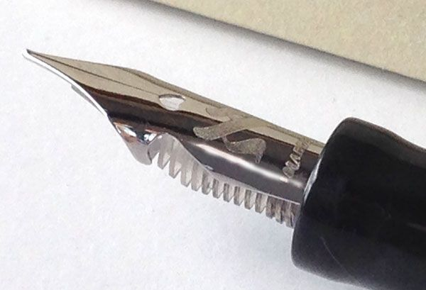 This is the spring nib of Marlen Aleph. The two indents at sides limit the flexibility, and the feeder is transparent! http://www.giardino.it/pens/marlen/aleph.php