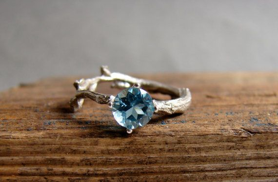 Swiss Blue Topaz Twig Engagement Ring: Looking for a non-traditional engagement ring? Try playing with different bands. This darling topaz ring has a little rustic charm with its silver twig band. | Citrine and Topaz Engagement Rings