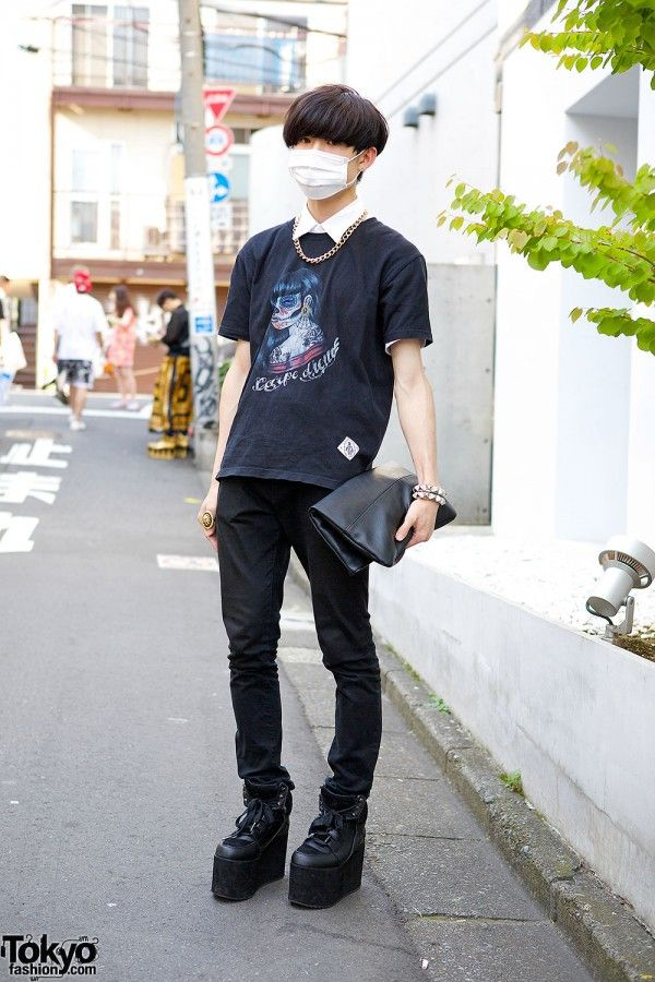 "Meet Yappi, a stylish 19-year-old fashion school student with short hair who caught the eye in Harajuku. Yappi is wearing a graphic t-shirt from Eyedy, which reads ""carpe diem"", over a white collar shirt. His jeans and clutch are resales, and his flatforms are from YRU. He is also wearing a chain necklace, oversized ring and studs bracelets, which are also resales. (Tokyo Fashion, 2014)"