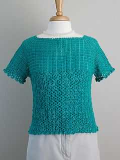 Pair this classic top with a skirt and pearls for a night out or with a pair of jeans for a cool summer evening! The body of the top is created using connect-as-you-go strips. Picots are incorporated into the bottom of each strip to create the border. The bodice and raglan-style sleeves are worked from the top of the strips up to the neck edge.