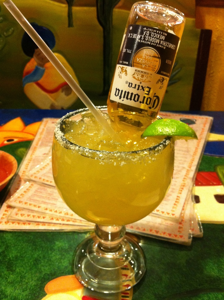 Margarita bomb - a regular margarita with a Coronita suspended in it.  As you sip the margarita, pull the Coronita up to fill the glass with beer.  Result = fizzy margarita.