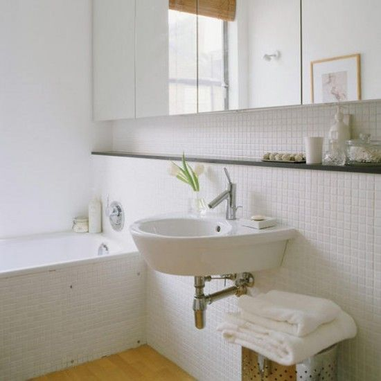 top floor bathroom ledge above sink & below cabinet White tiled bathroom with inset mirrored cabinets
