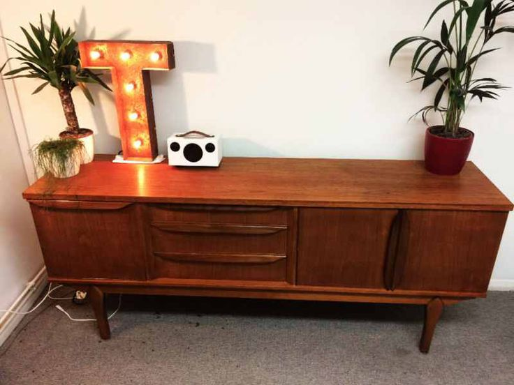 This is a great example of a Mid Century sideboard, solid teak, great condition for age. Very popular. Practical and stylish