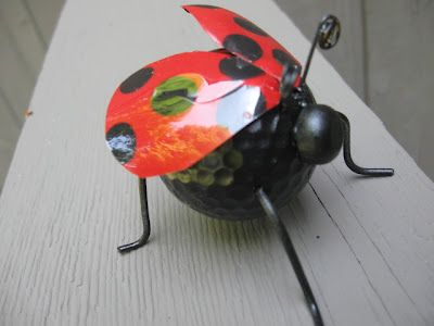 Cute ladybug craft. Great way to recycle golf balls, wire hangers and water bottles!