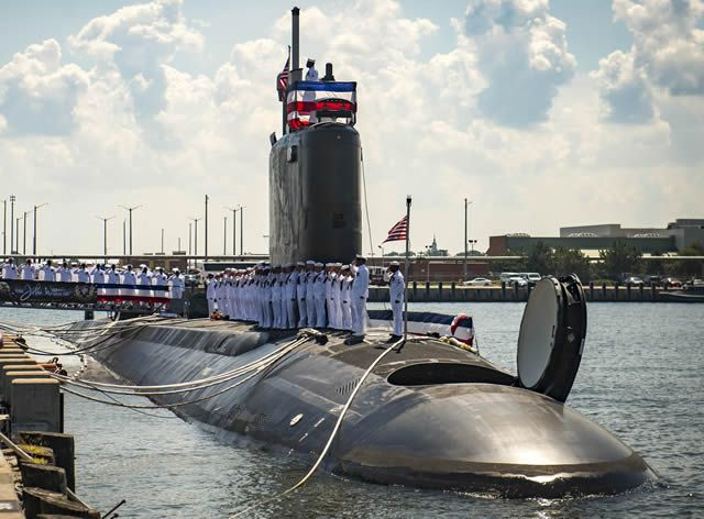 "The Virginia-class attack submarine USS John Warner (SSN 785) was commissioned during a ceremony attended by more than 2,500 in its future homeport of Naval Station Norfolk, Aug. 1, 2015. Proudly displaying its motto ""On a Mission to Defend Freedom,"" the ship is the 12th Virginia-class attack submarine to join the Navy's operating fleet."