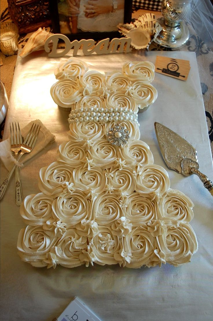 Cupcake pull-away bride's cake -- ZPatisserie.com embellished with pearls, brooch (Michaels),  Mr. Forks from Etsy (JLynnCreations).