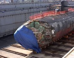The Los Angeles-class fast-attack submarine USS San Francisco (SSN 711) in dry dock to assess damage sustain...