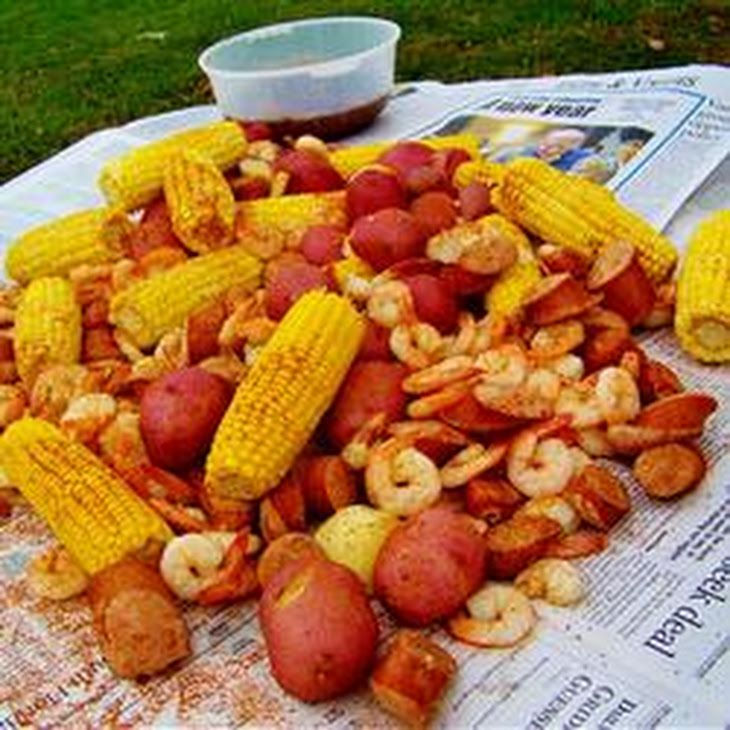 Dave's Low Country Boil Recipe Main Dishes with seafood seasoning, new potatoes, sausages, corn husks, whole crab, shrimp