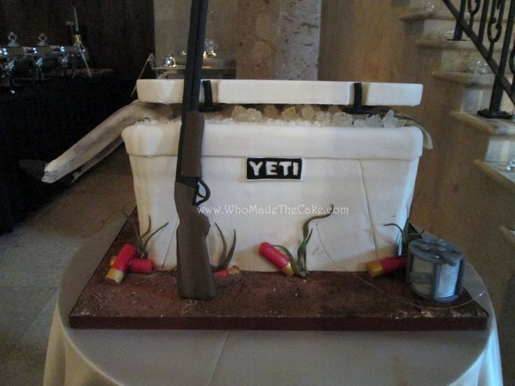 Yeti cooler groom's cake for the hunting enthusiast complete with a rifle, deer, fish, and more. www.WhoMadeTheCake.com #YetiGroomscake #huntinggroomscake