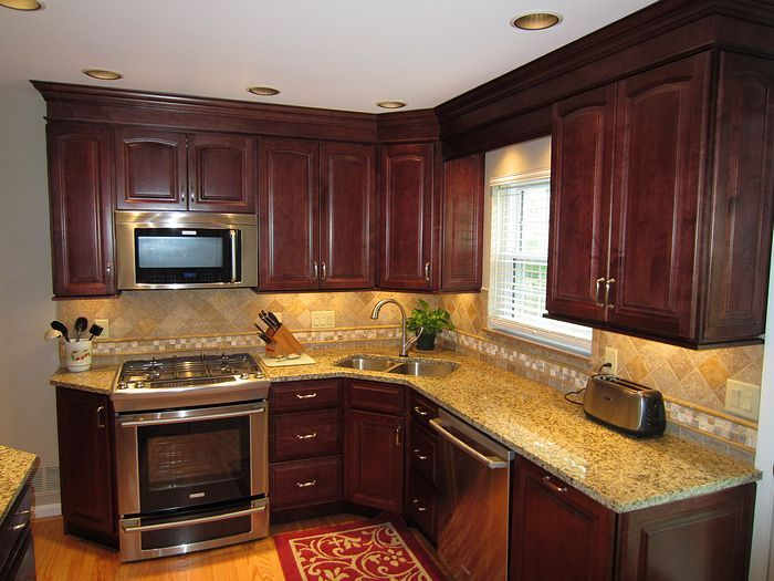 This is the color I would like my kitchen cabinets to be. Love the gold colored granite, too!