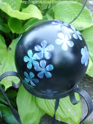 bowling ball-flowers made by covering those areas while the rest of the ball was painted.