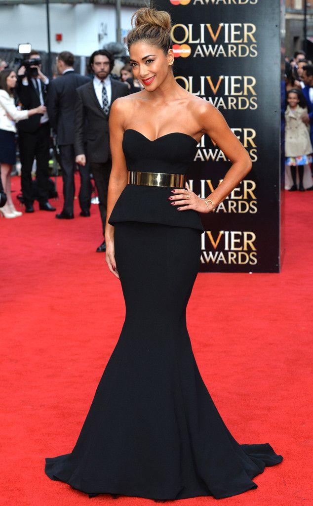 Perfection from Fashion Police  Nicole Scherzinger looks breathtaking! Was her goal to have all eyes glued to her on the red carpet? Because if so, she got exactly that. Her sleek, black peplum dress and wide, gold belt fit the singer flawlessly.