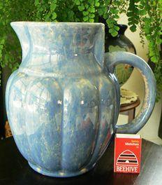 A vintage Temuka blue trickle glaze jug.