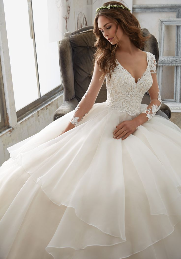 Trendy  IV This Ballgown Wedding Dress has Delicately Beaded Alencon Lace Appliqu s Illusion Sleeves