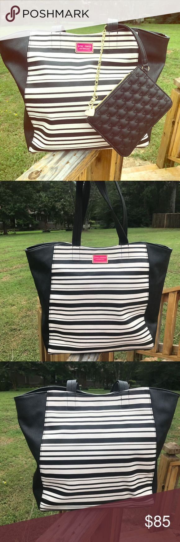 """Betsy Johnson tote bag/Bonus Wristlet Fun and cute black/cream tote bag by Betsy Johnson is in excellent condition. 13"""" (H) x 16"""" (w). Floral pattern interior. Wristlet is 5"""" (H) x 7"""" (w). Reasonable offers welcome Betsey Johnson Bags Totes"""