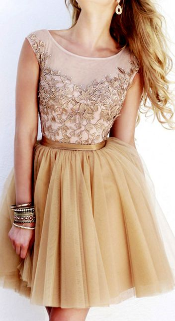 Golden tulle. How glam! I would dress it down with a tied chambray shirt and some white converse high tops, but that's just me