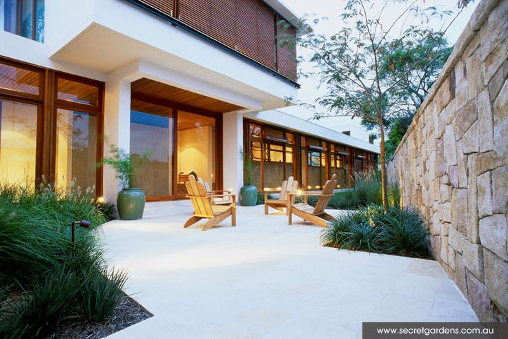 sandstone wall, pavers with garden.