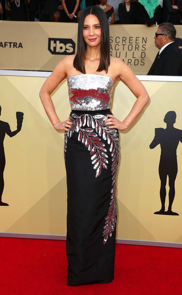 Olivia Munn from Standout Style Moments at SAG Awards 2018  The metallic leaves falling down skirt were beautiful to say the least.